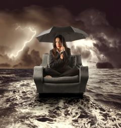 bigstock-overwhelmed-woman-on-a-chair-durring-a-storm